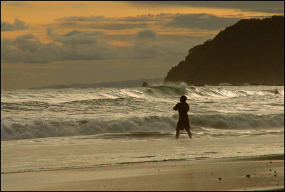 Fishing during sundown at Jaco Beach